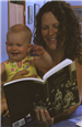 Woman Reads Cortland County History Book to Baby